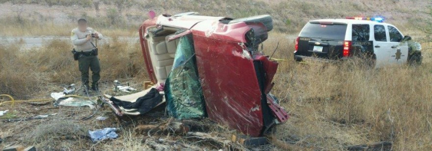 Photo 2 - Border Patrol agent encounters flipped vehicle (Photo courtesy of Customs and Border Protection)