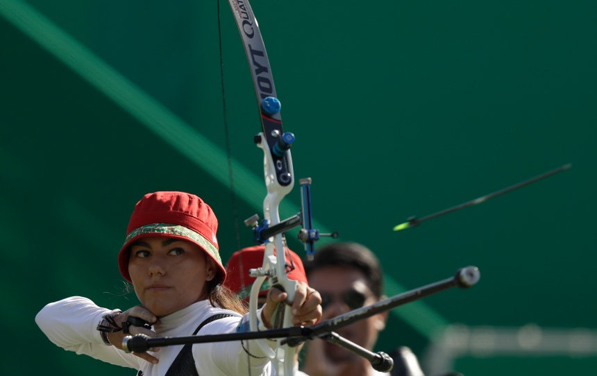 Mexico's Alejandra Valencia releases her arrow during the women's team archery competition at the Sambadrome venue during the 2016 Summer Olympics in Rio de Janeiro, Brazil, Sunday, Aug. 7, 2016. (AP Photo/Alessandra Tarantino)